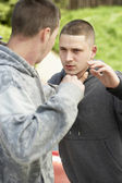 Two Young Men Fighting — Stock Photo
