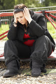 Young Woman Sitting In Playground — Stock Photo
