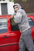 Young Man Breaking Into Car — Stock Photo