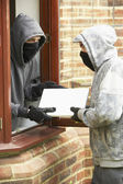 Young Men Breaking Into House — Stock Photo