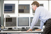 Stock Trader Examining Computer Monitors — Stock Photo