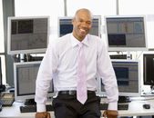Portrait Of Stock Trader In Front Of Computer Monitors — Stock Photo