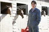 Portrait Of Vet Standing By Horse Stables — Stock Photo