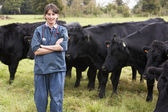 Portrait Of Vet In Field With Cattle — Foto de Stock