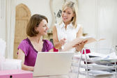 Women looking at paperwork together — Stock Photo