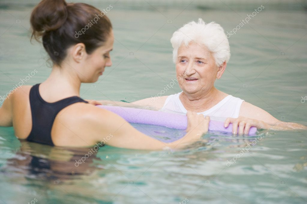 Instructor And Elderly Patient Undergoing Water Therapy — Stock Photo #4794209