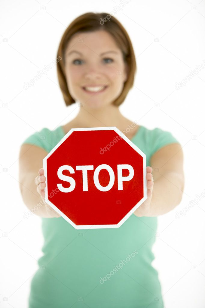 Woman Holding Road Traffic Sign — Stock Photo #4796052