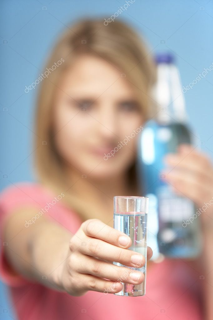 Teenage Girl Holding Glass Of Spirits  Stock Photo #4796209