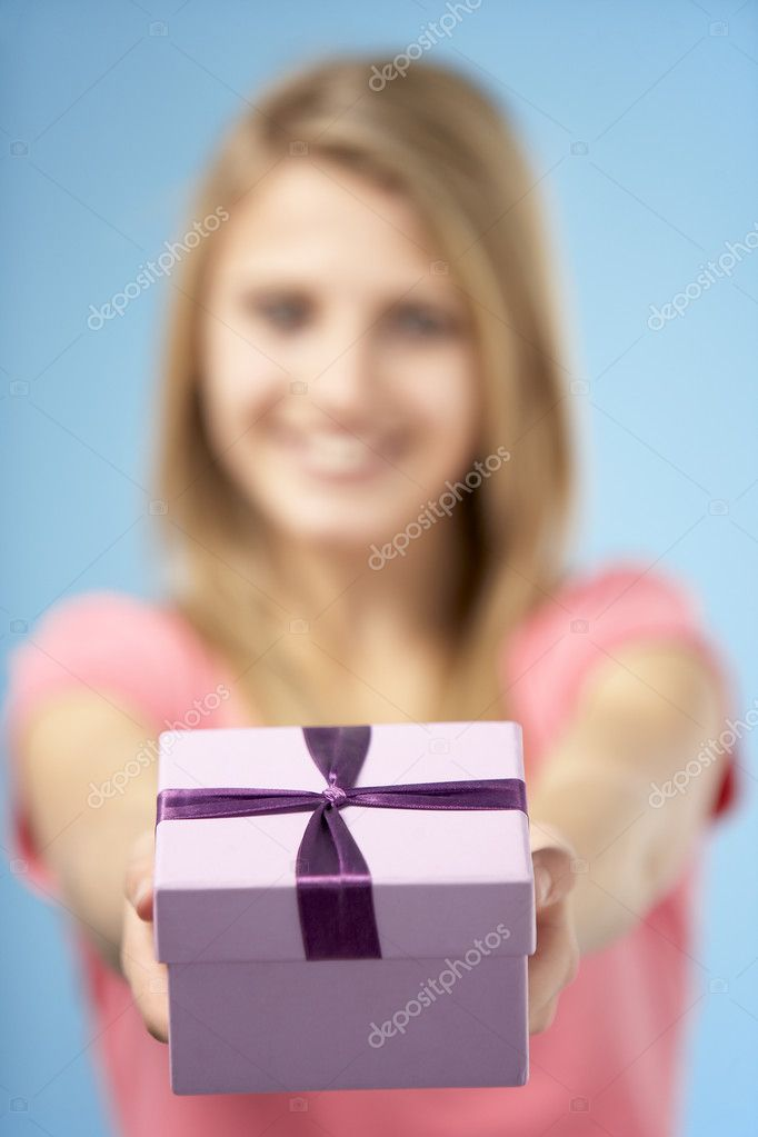 Teenage Girl Holding Gift Wrapped Box — Stock Photo #4796216