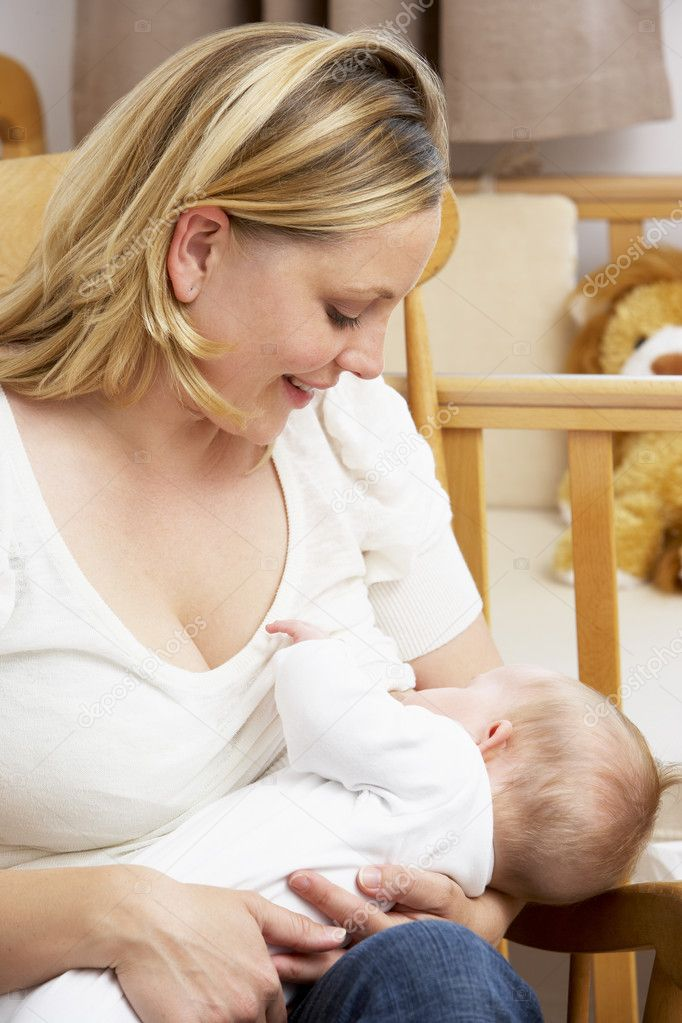 Mother Breastfeeding Baby In Nursery  Stock Photo #4796402