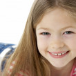 Studio Portrait of Smiling Girl — Stock Photo