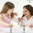 Two Young Girls Brushing Teeth at Sink — Stock Photo