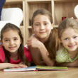 Three Young Girls Reading Book at Home — Stock Photo