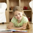 Young Girl Reading Book at Home — Stock Photo