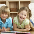Two Young Children Reading Book at Home — Stock Photo