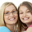 Studio Portrait of Smiling Teenage Girl with older Sister - Foto de Stock  