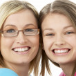 Studio Portrait of Smiling Teenage Girl with older Sister - Stock Photo