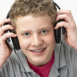 Portrait of Smiling Teenage Boy Listening to Music - Stockfoto