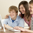Teenagers on Computer at Home — Stock Photo