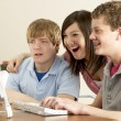 Stock Photo: Teenagers on Computer at Home