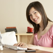 Smiling Teenage Girl on Computer at Home — Stock Photo
