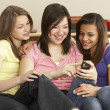 Teenage Girlfriends Reading Mobile Phone at Home — Stock Photo #4814701