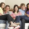 Stock Photo: Teenage Friends Relaxing at Home