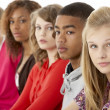 Studio Portrait Of Five Teenage Friends Standing In Line — Stock Photo #4814849