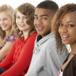 Stock Photo: Studio Portrait Of Five Teenage Friends Standing In Line