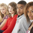 Studio Portrait Of Five Teenage Friends Standing In Line — Stock Photo #4814851