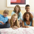 Group Of Five Teenage Friends Hanging Out In Bedroom — Photo