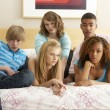 Group Of Five Teenage Friends Looking Bored In Bedroom — Stock Photo