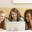Group Of Three Teenage Girls Using Laptop In Bedroom — Stock Photo #4814930