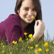 Teenage Girl Laying In Summer Meadow - Stock Photo