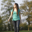 Teenage Girl Walking Through Summer Meadow — Stock Photo