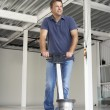 Cleaner polishing office floor - Stock Photo