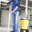 Cleaner mopping office floor — Stock Photo