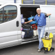 Cleaner standing next to van — Stock Photo