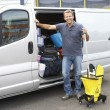 Royalty-Free Stock Photo: Cleaner standing next to van