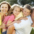 Family having fun in countryside — Stock Photo #4815314