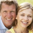 Close up of middle aged couple outdoors — Stock Photo #4815328