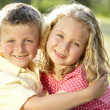 2 Children hugging outdoors — Foto Stock