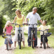 Family riding bikes in countryside — Stock Photo