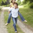 Young couple having fun in countryside — Stock Photo