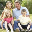 Family relaxing in countryside — Stock Photo #4815383