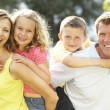 Family having fun in countryside — Stock Photo #4815387