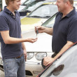 Young man collecting new car — Stockfoto