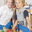 Two Young Boys Playing Together in Sandpit — Stock Photo #4815438
