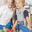 Two Young Boys Playing Together in Sandpit — Stock Photo