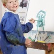 Stock Photo: Young Boy Painting